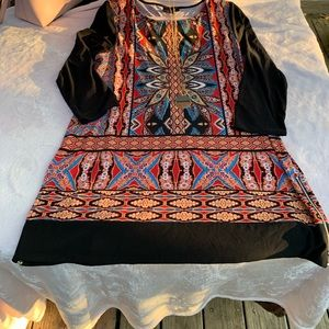 Super cute tunic or dress.